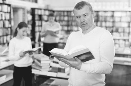 Man finding a book in a bookstore